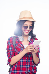 Happy young asian woman using smartphone standing isolated on white.
