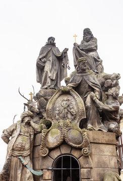 Statues of Saints John of Matha, Felix of Valois, and Ivan on Charles Bridge in Prague, Czech Republic