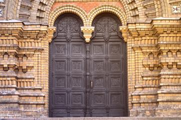 Old wooden door of yellow-gray color