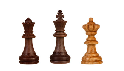 Chess pieces: black king between two queens