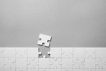 Jigsaw puzzle on light background