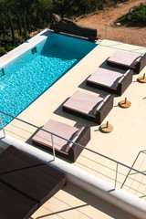 Long straight pool in modern white house