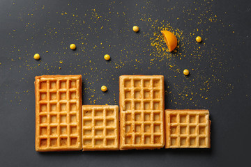 Creative composition with waffles on black background