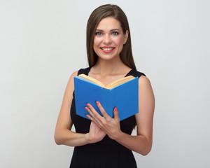 teacher woman wearing black dress holding open book.