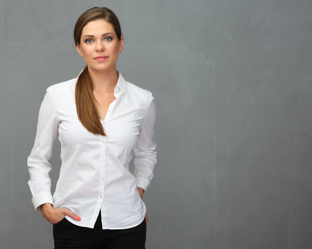 Confident business woman in white shirt isolated portrait