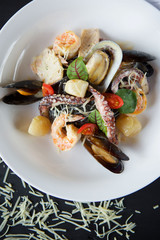 Shrimp clams and octopuses served with cheese and basil