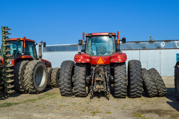 Russia, Temryuk - 15 July 2015: Tractor. Agricultural machinery tractor. Parking of tractor agricultural machinery. The picture was taken at a parking lot of tractors in a rural garage on the