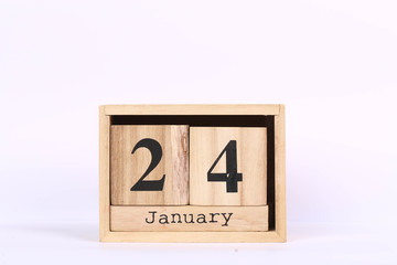 Wooden cubes calendar with the date of January 24. Concept calendar for year with copy space isolated on white background