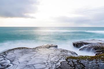 Wave break over intertidal flats at low tide