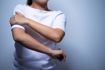 Woman has muscle pain and injury