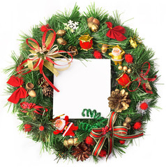 Merry Christmas. Christmas card with a wreath and decorations with a white leaf. Christmas background.
