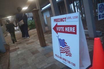 Voters head to a polling station in Tallahassee, Florida
