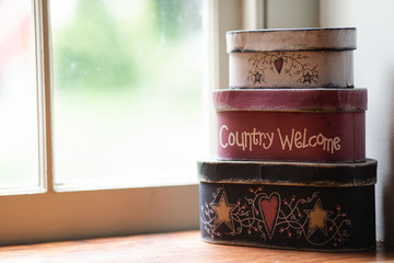 Cute stacked storage boxes on window ledge Wall mural