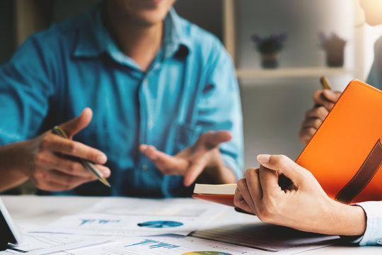 Business adviser analyzing financial figures denoting the progress in the work of the company, Business Discussion Concept