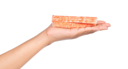 hand holding crab stick isolated on white background