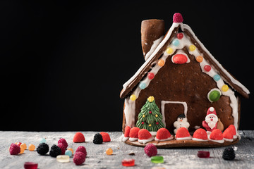 homemade gingerbread house on a table