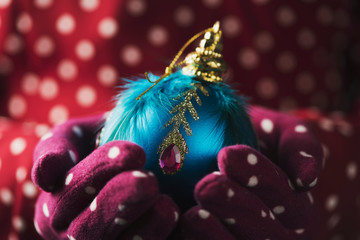 woman with an ornamented christmas ball