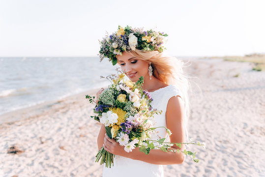 beautiful bride walks near the sea