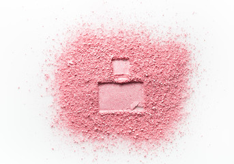Imprint of perfume bottle on pink face powder. Isolated on a white background.