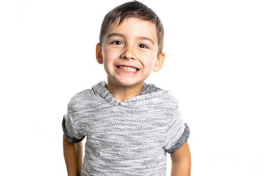 Boy having fun on studio white background