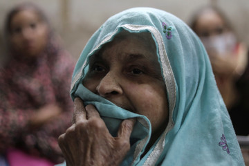 A woman waits to receive treatment for respiratory issues at Ram Manohar Lohia hospital in New Delhi