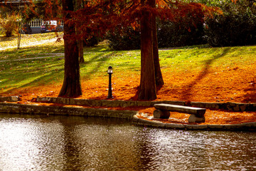 Autumn, beautiful small lake surrounded by trees in the park. Pond in Vrnjacka Banja resort in serbia.
