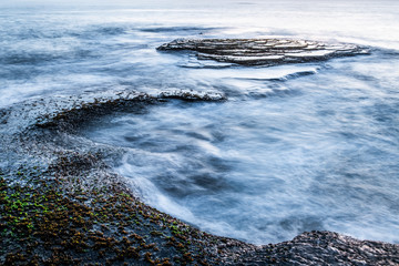 Wave break over intertidal flats at low tide