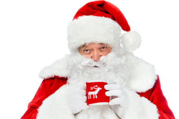 smiling santa claus with white beard holding coffee cup isolated on white