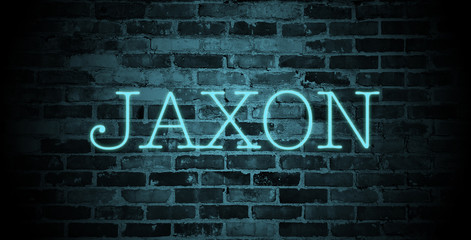 first name Jaxon in blue neon on brick wall