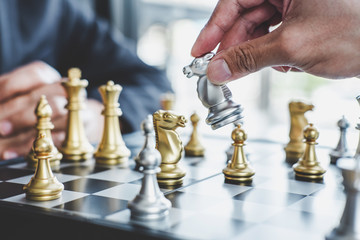 Two businessman playing chess game to plan strategy for success, thinking for planning overcoming difficulty and achieving goals business strategy for win