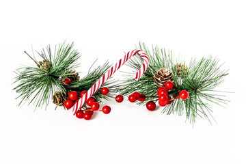 christmas tree branch with red balls and candy cane