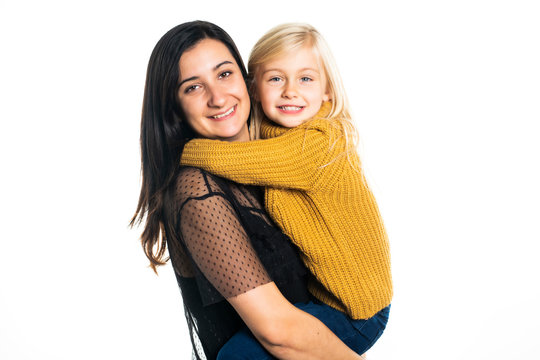 A mother and daughter on studio white background