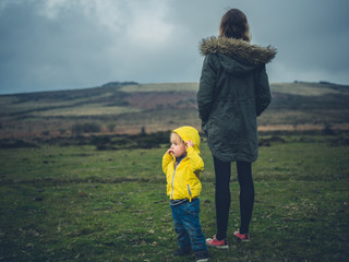 Mother and toddler standing on the moor