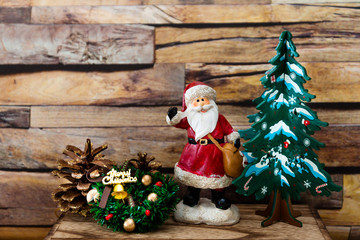 Santa Claus figurine christmas decoration over wooden background