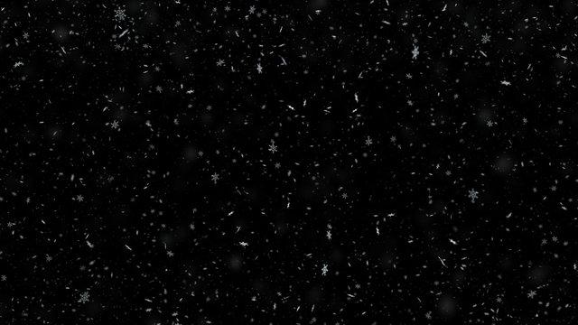 Snowflakes falling on black background