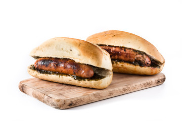 Choripan. Traditional Argentina sandwich with chorizo and chimichurri sauce. isolated on white background