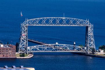 Aerial lift bridge in Duluth, Minnesota on a blue Lake Superior