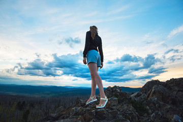 Travel, lesure and freedom concept - woman on the top of Altai mountain, beauty summer evening landcape