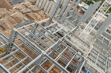Top view of steel girders. General view of a tall construction beams