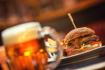 american hamburger with glass of beer of wine in american restaurant, product photography for restaurant in american style