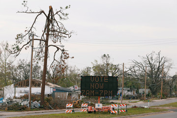 A sign directs voters to a new polling location where Hurricane Michael destroyed many schools and other buildings used as polling stations in the area in Parker, during the midterm elections