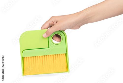 hand holding Dust brush broom isolated on white background