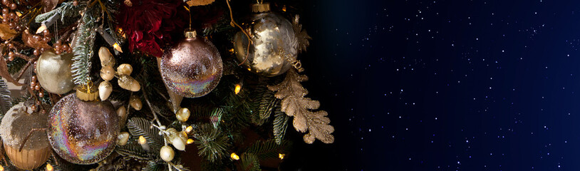 Christmas tree and ball toys against the starry sky