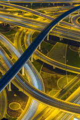 Vertical aerial photo of a Dubai highway interchange at night