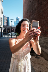 Beautiful Woman Taking Picture with Her Phone