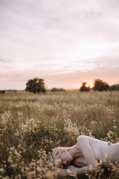 Naked woman in summer field