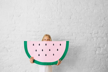 Portrait Of Happy Child With Crafted Watermelon
