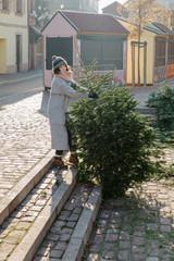 Woman taking fir tree