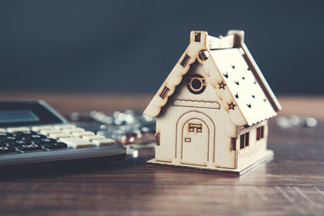 house model and calculator with coins