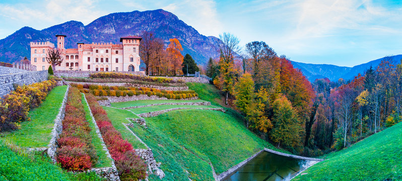 Ceconi Castle in an autumnal landscape at sunset